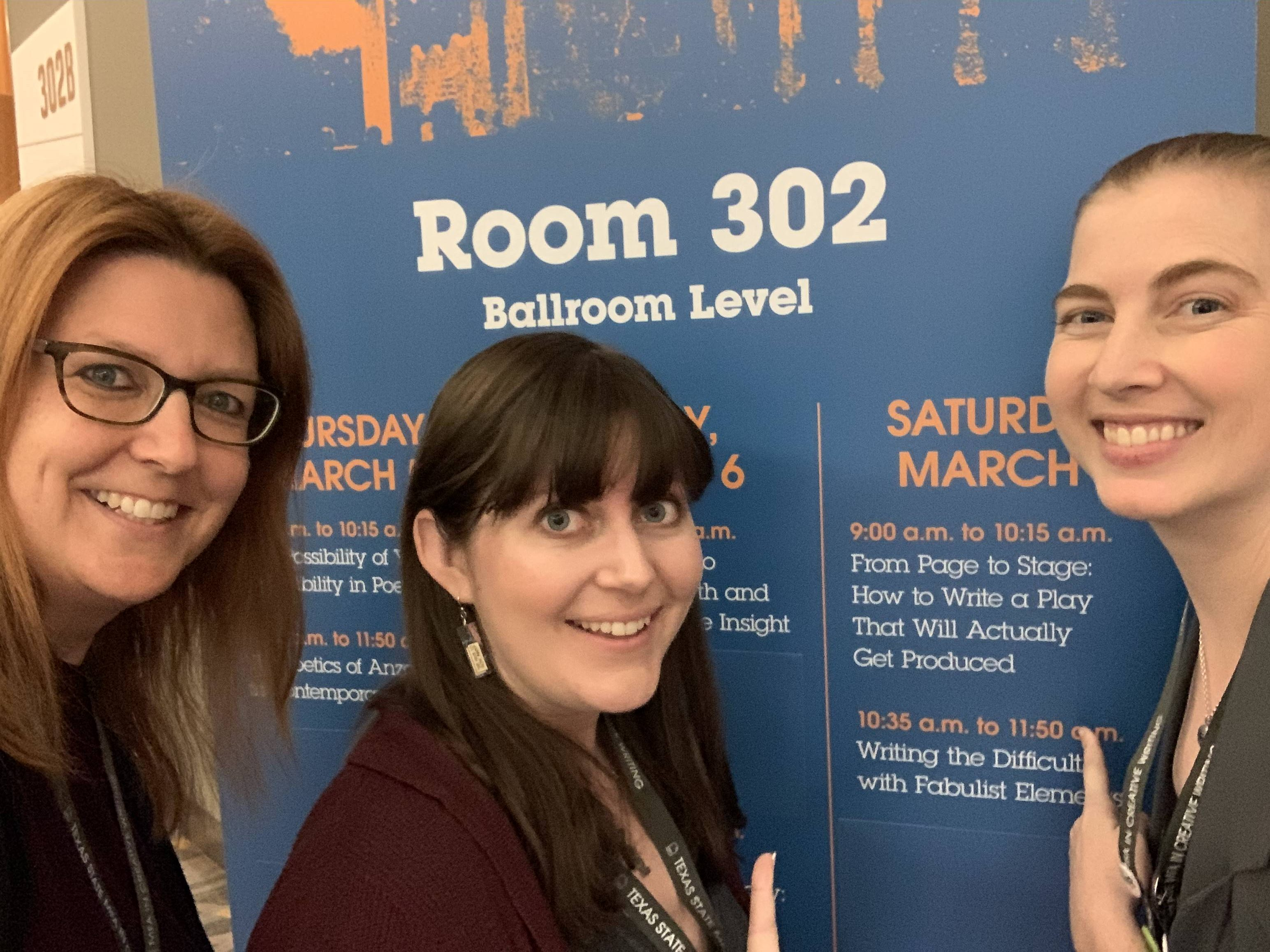 Annlee, Jessica, and Lauren outside of our panel room.